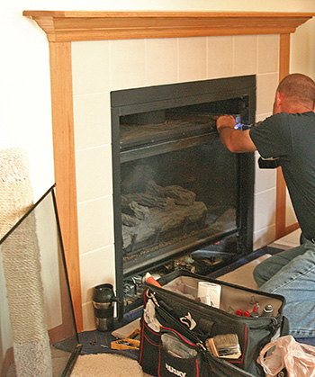 Fireplace maintenance by service technician in River Pine CA
